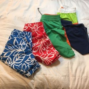 Pack of 4 boys swim bottoms mixed brands.
